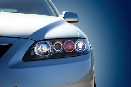blue modern car closeup. Light of car.